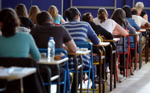 French students work on the test of Philosophy as they take the baccalaureat exam (high school graduation exam) on June 18, 2012 at the Pasteur high school in Strasbourg, eastern France. Some 703.059 candidates are registered for the 2012 session. The exam results will be announced on July 6, 2012. AFP PHOTO / FREDERICK FLORINFREDERICK FLORIN/AFP/GettyImages