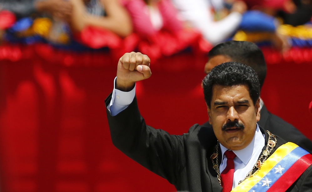 Venezuelan President Maduro arrives at a military parade to commemorate the first anniversary of the death of Venezuela's late president Chavez in Caracas