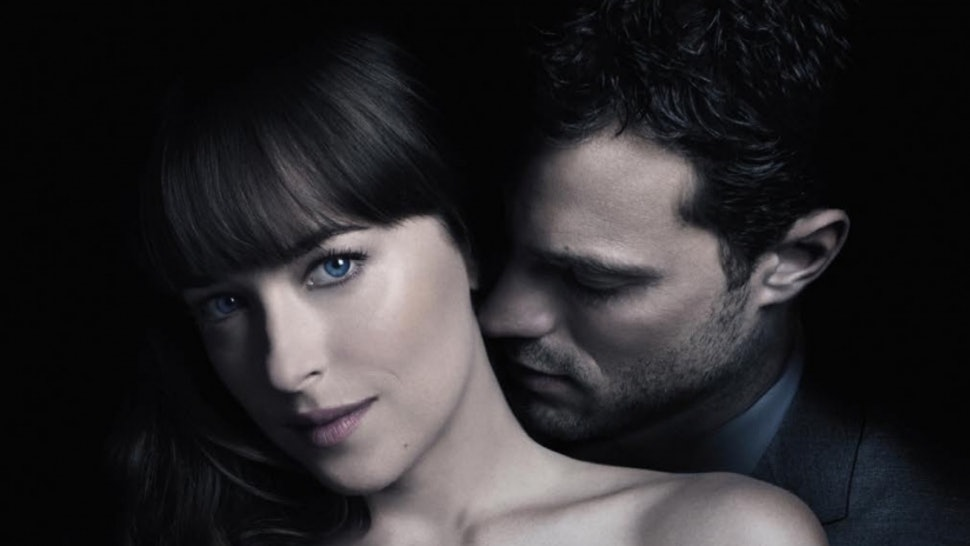 In foto, Anastasia Steele (Dakota Johnson) e Christian Gray (Jamie Dornan), protagonisti dei film della trilogia Fifty Shades